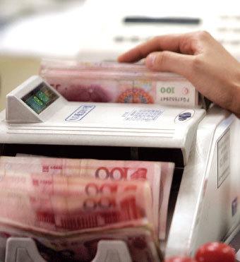 國際貨幣基金組織(IMF)警告中國企業債問題嚴重,應該盡快處理。(法新社)