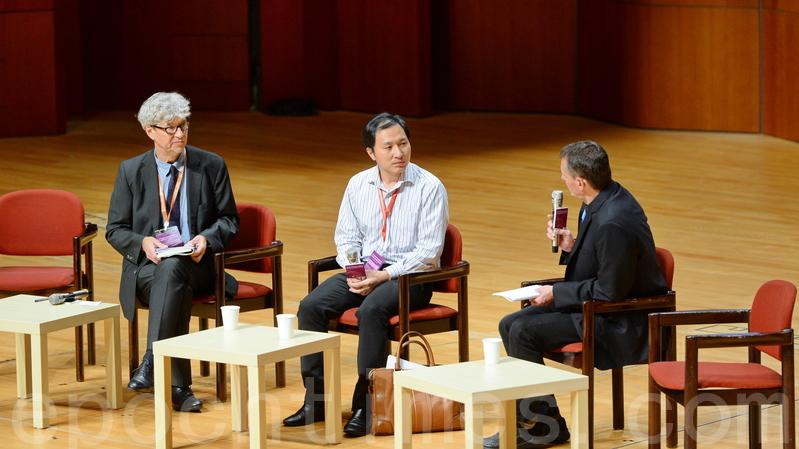 中共首創「基因編輯嬰兒」而被全球專家聲討的深圳南方科技大學副教授賀建奎(中),今日中午在港大出席人類基因編輯峰會演講。(宋碧龍/大紀元)