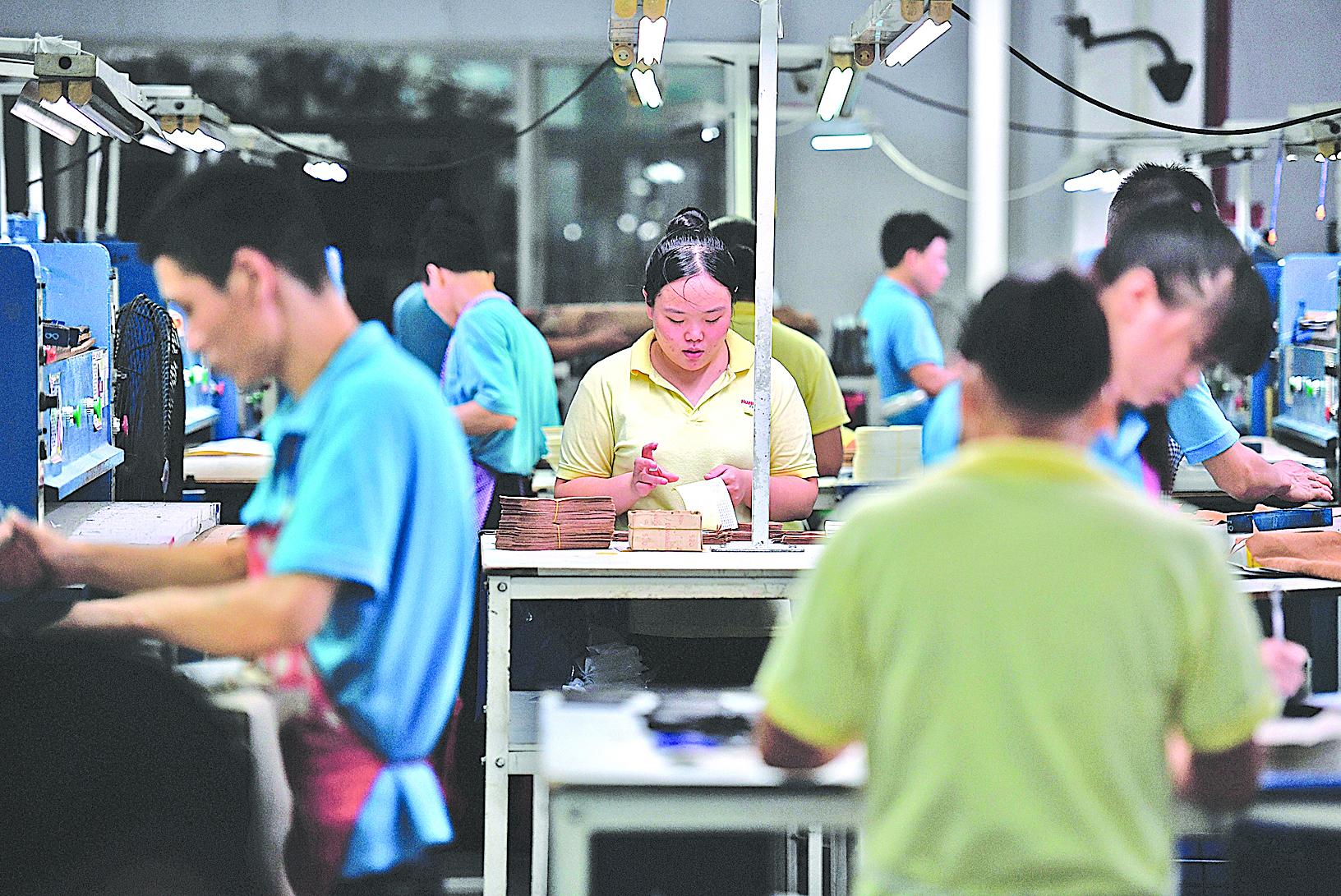 近來中國經營環境惡化,台商的中國夢碎,紛紛撤資,以廣東為例,早已出現「逃命潮」。(AFP)
