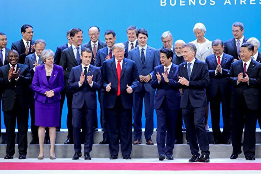 習特會前,美國總統特朗普周五表示,跡象顯示,與中方的會談會有一些好的結果。圖為G20峰會開幕式。(LUDOVIC MARIN/AFP/Getty Images)