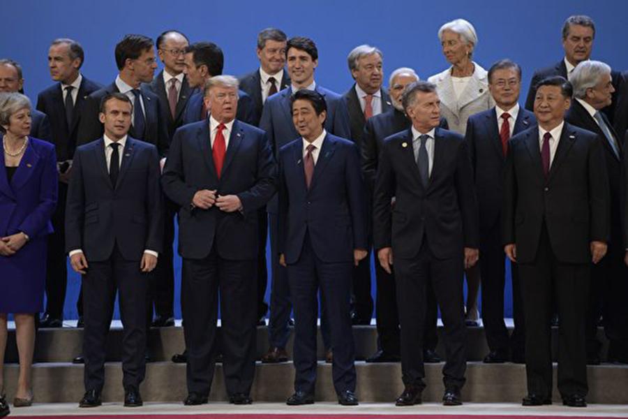 經過一週的密集商討及前一天的挑燈夜戰,二十國集團(G20)終在週六(12月1日)化解分歧,發表了領袖聲明(或稱公報)。主要參與人員透露談判內幕,密集談判程度前所未有。(JUAN MABROMATA/AFP/Getty Images)