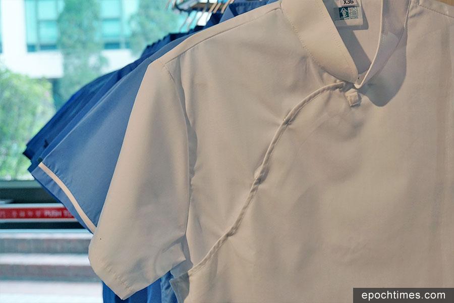 旗袍裝採用布藝鈕扣設計。(曾蓮/大紀元)