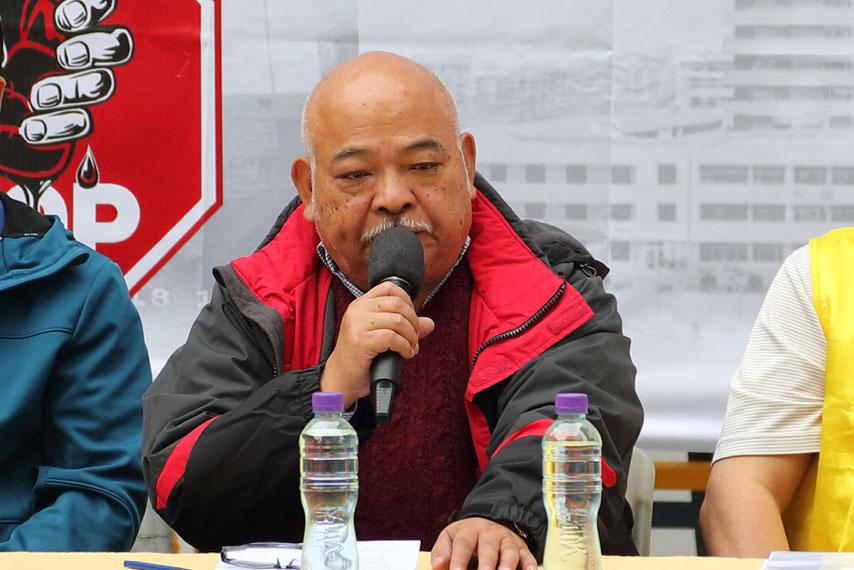 香港前立法局議員曾健成在12月9日的國際人權日法輪功反迫害集會上發言。(李逸/大紀元)