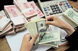 人民幣難以真正國際化  美元穩坐全球主導地位