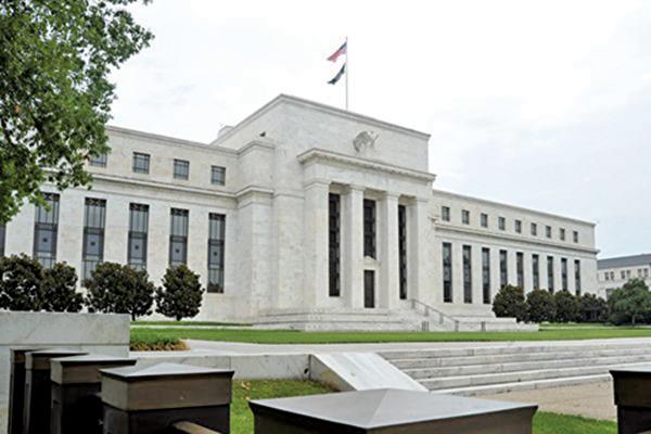 根據美聯儲周三(2月20日)公佈上個月底的議息會議記錄,美聯儲官員同意在今年宣佈結束四萬億美元資產負債表的縮表。 (KAREN BLEIER/AFP/Getty Images)