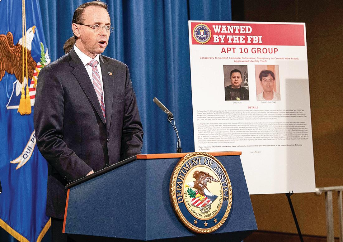 美國司法部去年12月起訴兩名中共黑客組織APT 10成員。(AFP)