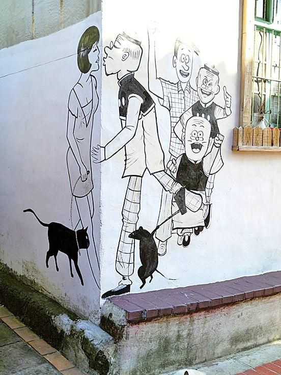 彩繪於自宅前的壁畫「轉角遇到愛」充滿文青感。