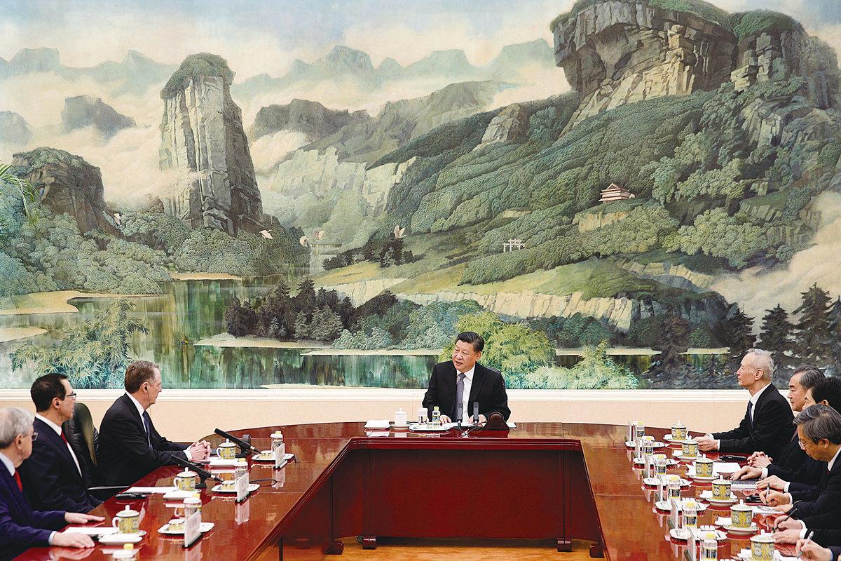 圖為2月15日,習近平在北京會見美國貿易談判代表。(Getty Images)