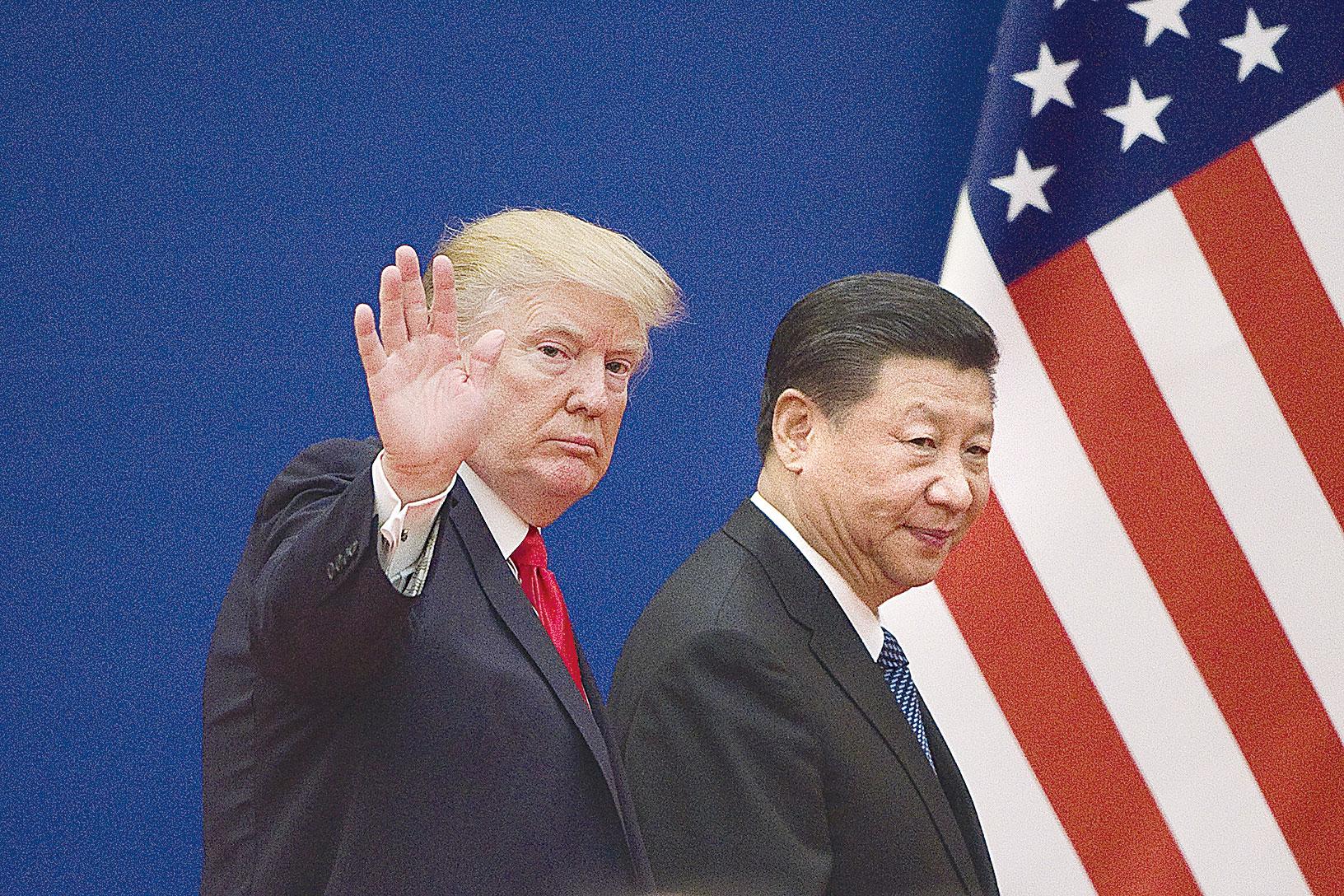 圖為2017年11月9日,特朗普和習近平在北京會面。(Getty Images)