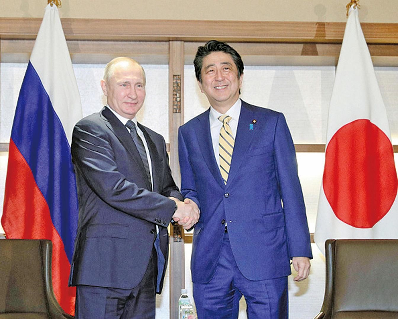 圖為2016年12月15日晚,日本首相安倍晉三與俄羅斯總統普京舉行會談,雙方就和平協議以及北方四島問題展開了約3個多小時會談。(Getty Images)