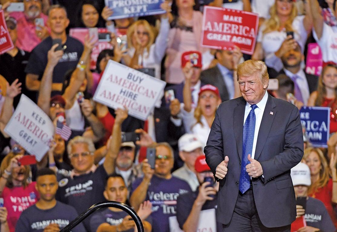根據兩份最新民調,特朗普總統支持率及經濟施政滿意度雙破50%。(AFP)