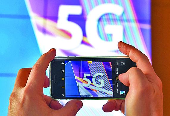 今年的最熱的網絡話題就是5G。(ARNE DEDERT/AFP/Getty Images)