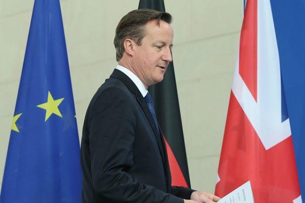 首相卡梅倫決定的背後,還有一些不便公開的原因。(Photo by Sean Gallup/Getty Images)