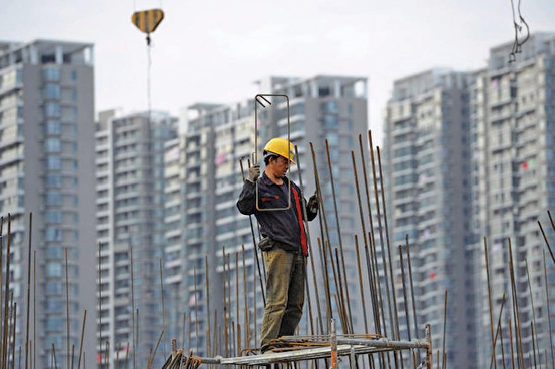 大陸房企近來頻繁拿地,土地財政再次回暖。(AFP)