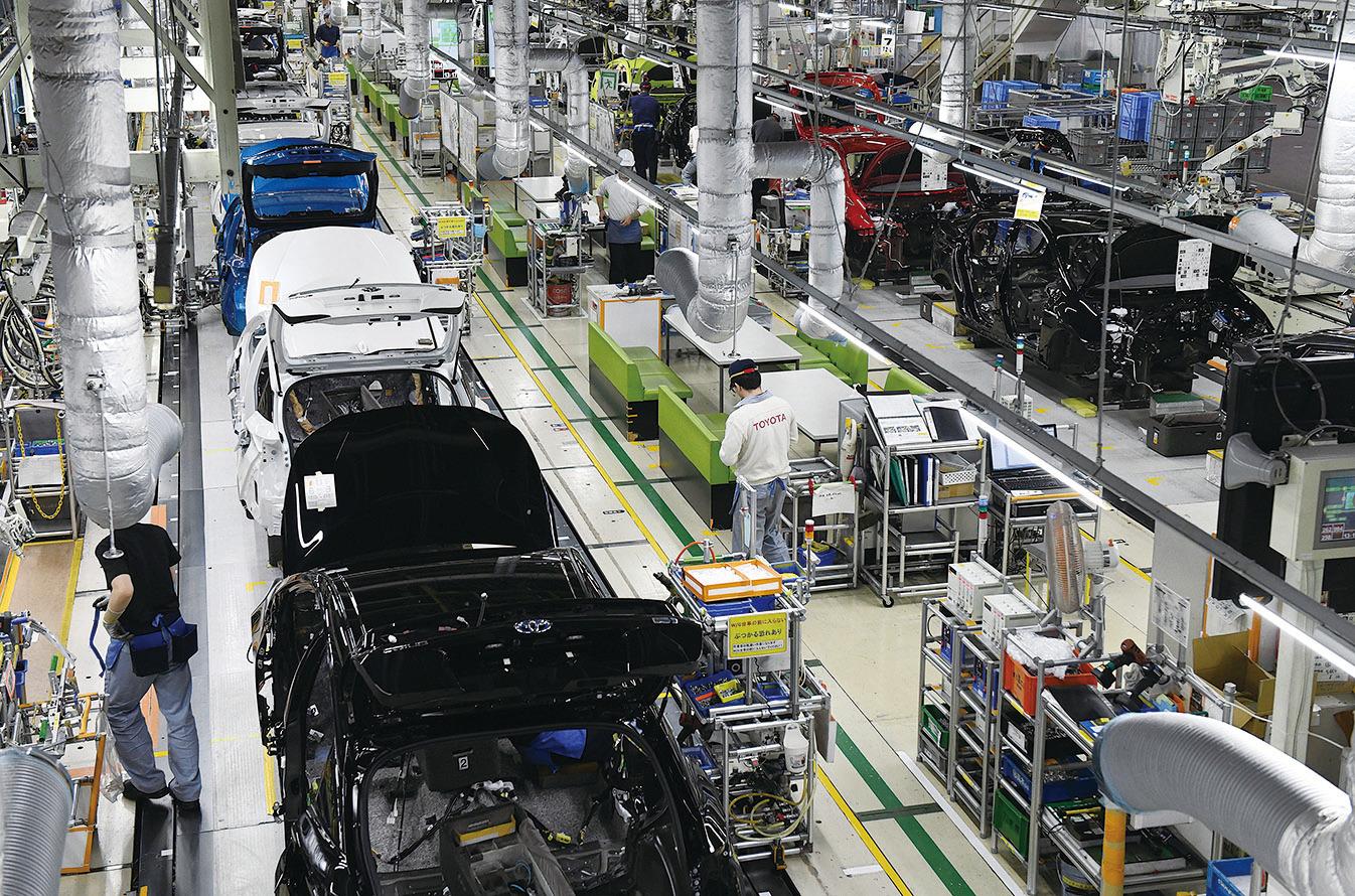 豐田汽車的創業理念是通過公平競爭,力爭成為國際社會信賴的「企業市民」作為發展目標,為社會發展做貢獻,要求員工具備職業操守和團隊精神。圖為日本豐田車廠。(Getty Images)