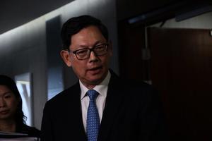 金管局總裁陳德霖:港無可避免受中美貿戰牽連
