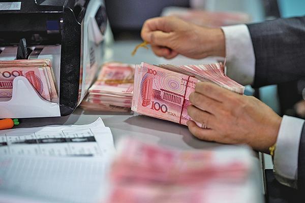 人民幣兌美元中間價、在岸價、離岸價5月17日均大跌。圖為示意照。(AFP)