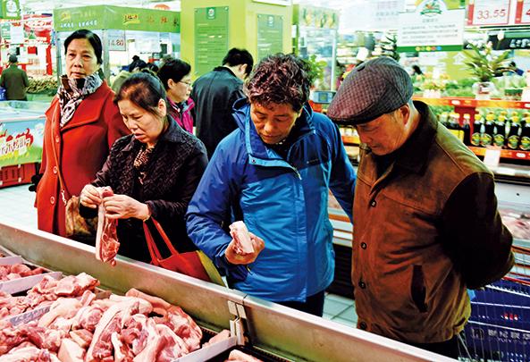中共目前對美國豬肉產品徵收62%的關稅,將悉數轉嫁給中國百姓。(Getty Images)