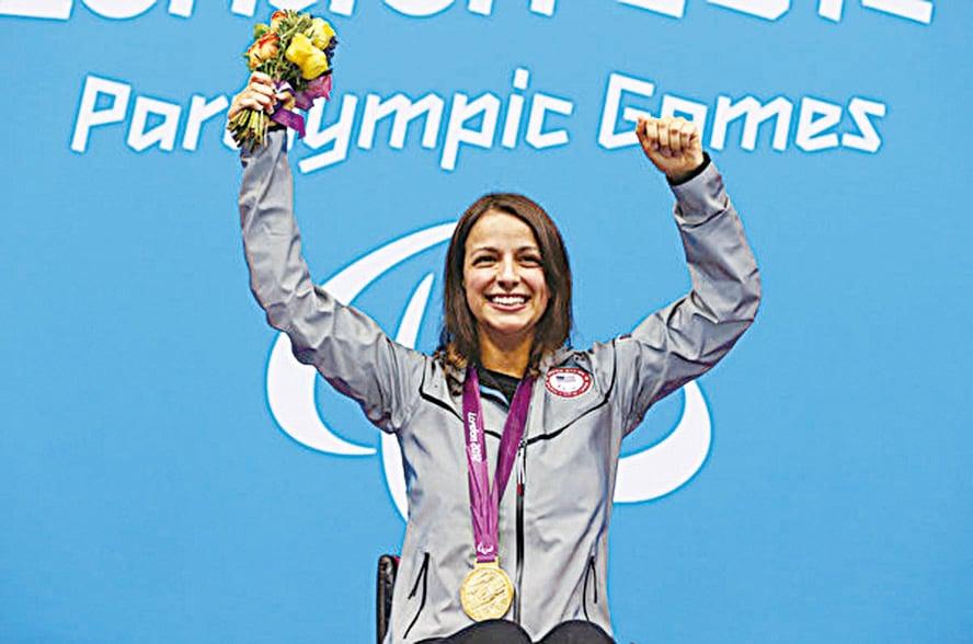 維多莉亞於2012年獲得殘奧會女子100米自由泳金牌。(Clive Rose/Getty Images)