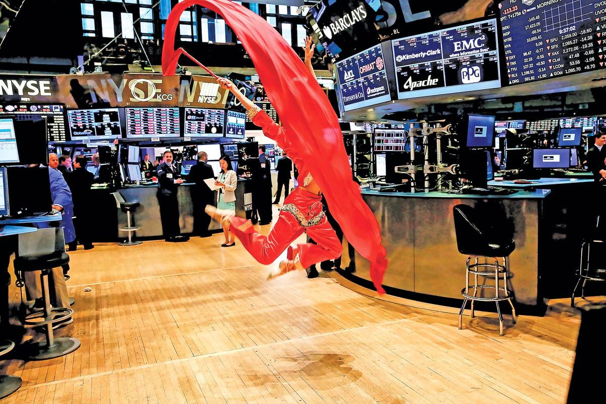 掌握美國金融行業的華爾街近些年持續幫中共輸血。(AFP)