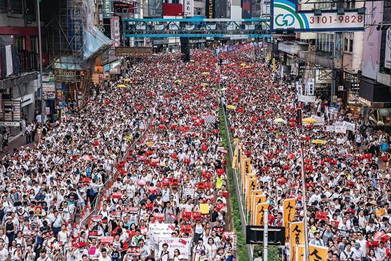 6月9日,香港百萬人上街大遊行「反送中」,即反對港府欲對「引渡條例」立法。(Getty Images)