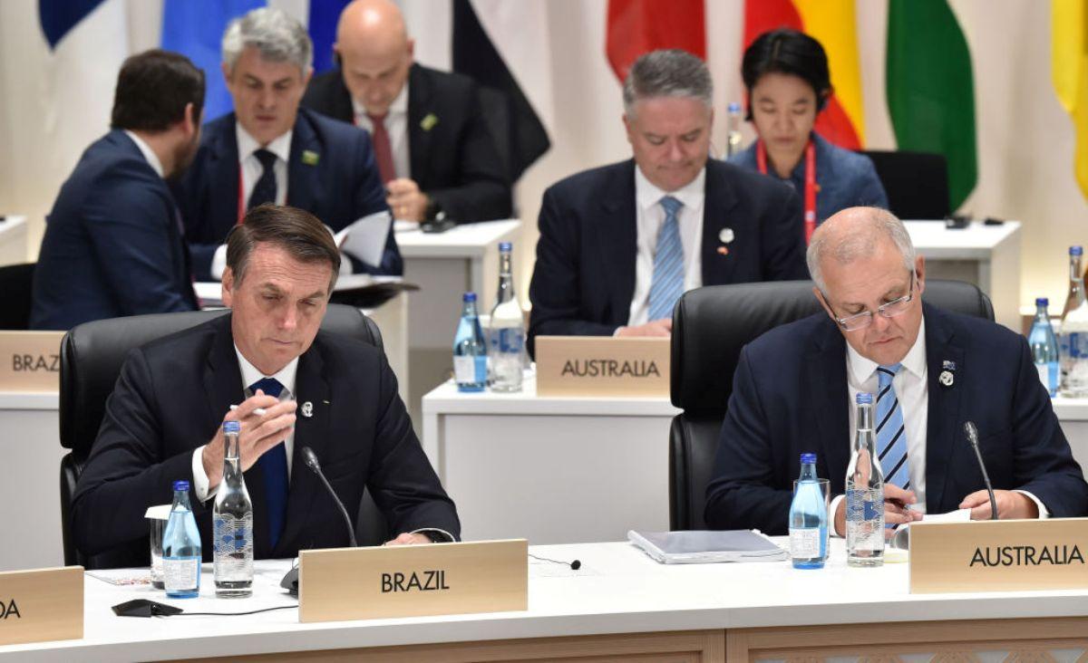 圖為巴西總統Jair Bolsonaro(左)2019年6月29日在日本大阪出席G20峰會時的一個場景。(Kazuhiro NOGI - Pool/Getty Images)