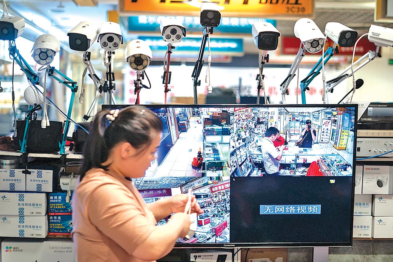 中共向海外輸出監控技術的同時,從某種意義上也是在輸出其集權化的體制。(AFP)