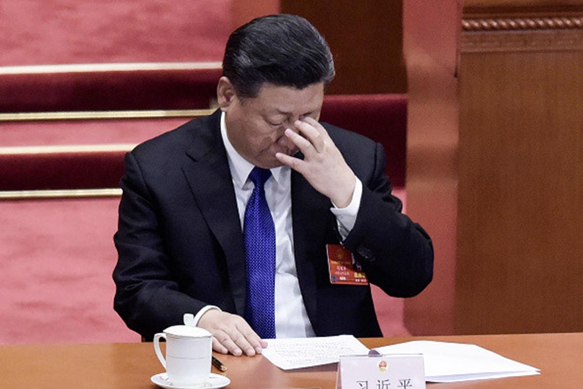 近日黨報再度刊登習的文章,要求提高中共高官的防範政治風險等能力。(FRED DUFOUR/AFP/Getty Images)