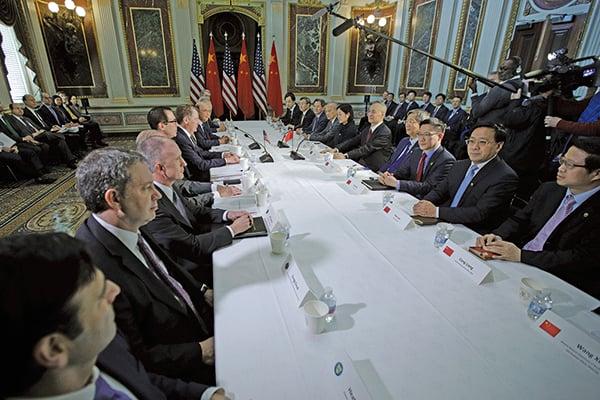 圖為中美今年2月21日的貿易談判。(AFP)