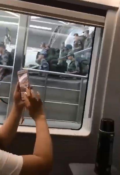 25日臉書傳出影片指香港高鐵站出現大批軍人,但原影片隨後被刪除。(影片截圖)