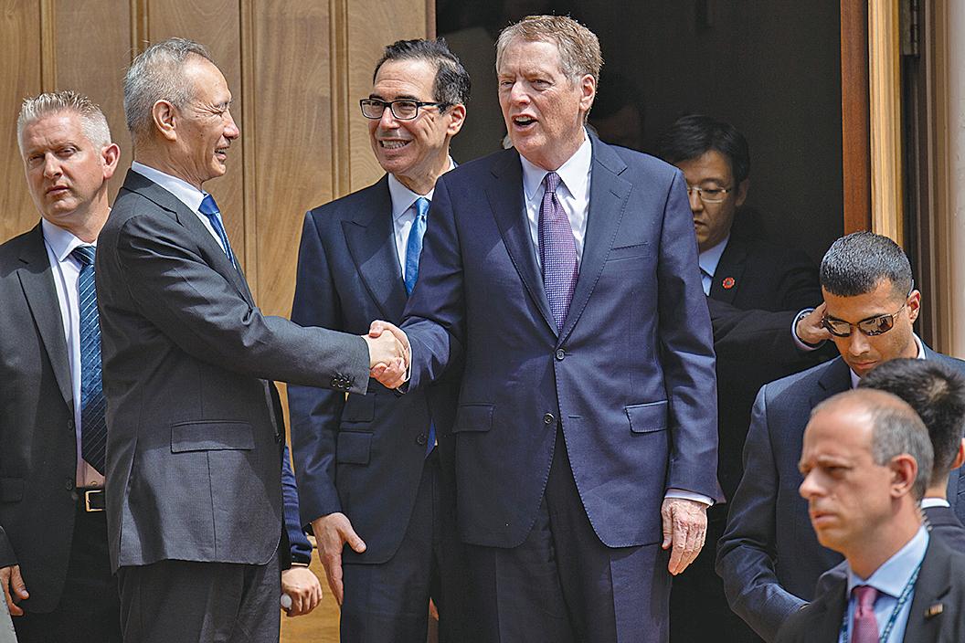 周二(7月30日)中美恢復一度中斷的貿易談判,但外界對這次談判的期待普遍不高。圖為雙方談判資料照。(AFP)