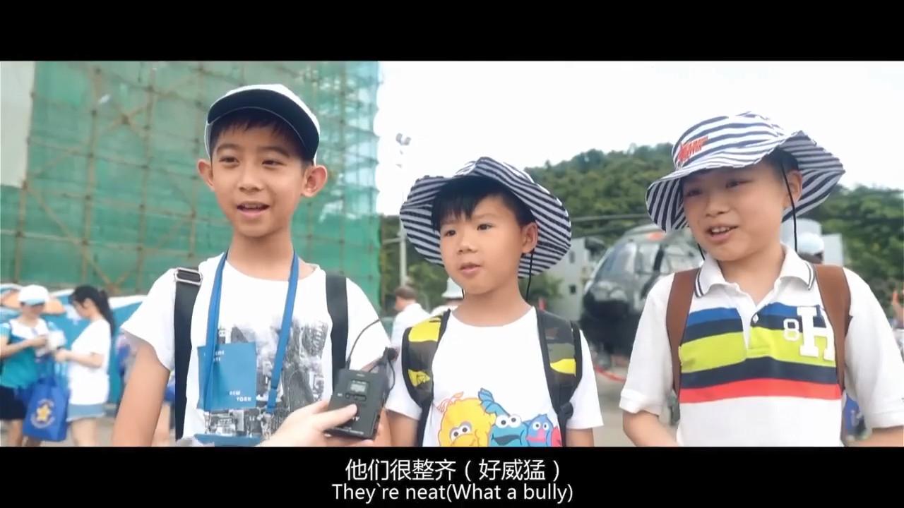 影片中有小孩受訪時指中共軍人「好威猛」的英文字幕被翻譯成「What a bully(恃強凌弱者)」,引來網民恥笑。(影片擷圖)