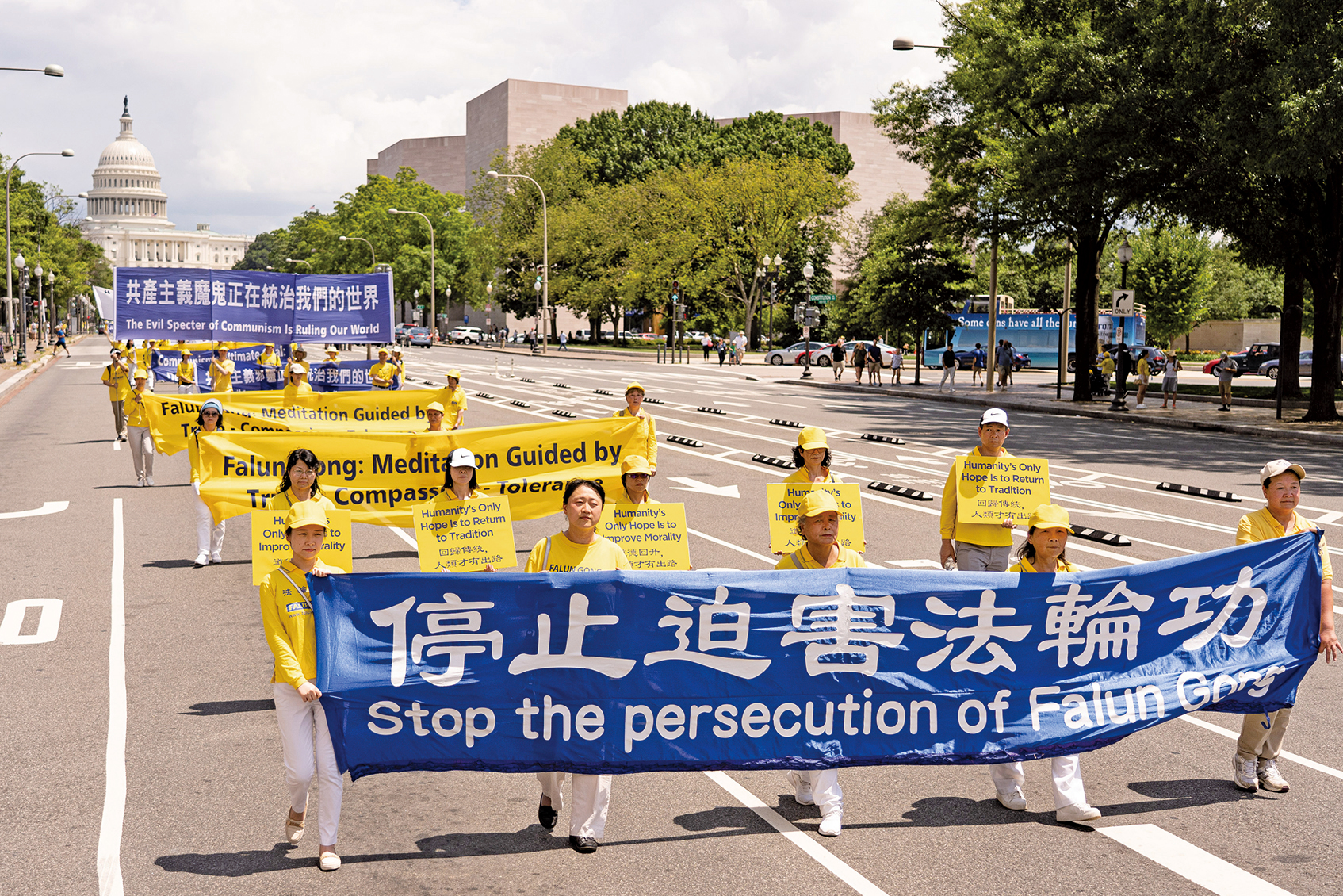 圖為2019年7月18日,法輪功學員聚集在華盛頓DC舉行法輪功反迫害20周年大型集會遊行。(戴兵/大紀元)