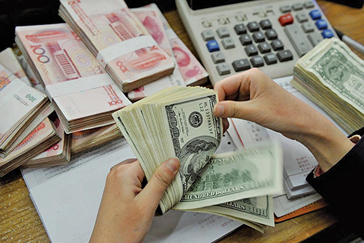 隨著貿易戰升級,有機構預測人民幣兌美元將貶值至7.5。(Getty Images)