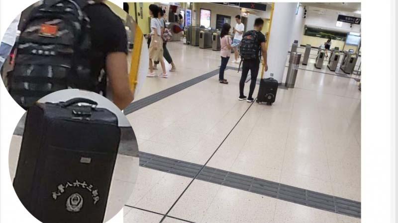 8月8日,香港網友表示,拍到疑似便衣武警現身鋼鐵。(網絡圖片)