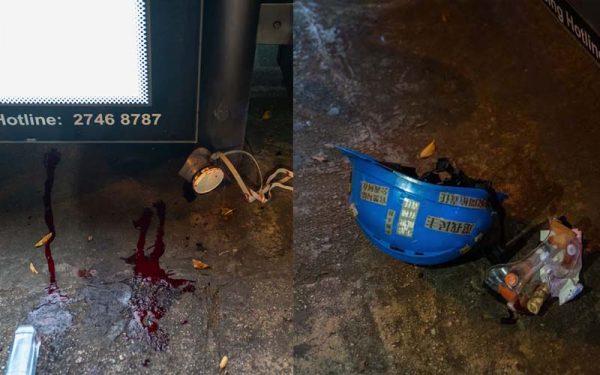 圖為8月11日,一名示威少女被打爆右眼後,遺留在現場的滿地鮮血,頭盔和嵌有布袋彈的護目鏡。(Billy H.C. Kwok/Getty Images)