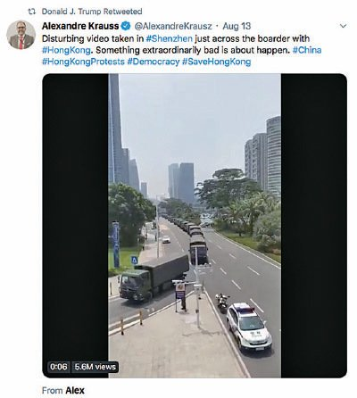 特朗普8月13日轉推了中共多輛軍車在香港邊境移動的片段。(Twitter截圖)