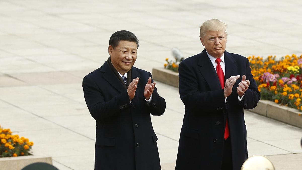 美國總統特朗普一連3天呼籲北京人道解決香港問題,他還打賭,習近平15分鐘內能解決問題,但習不會。( Thomas Peter-Pool/Getty Images)