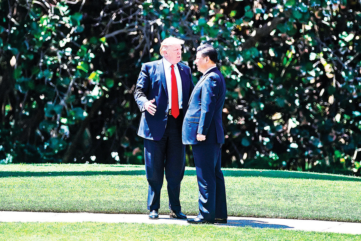 美國總統特朗普8月14日發推文提議和中國國家主席習近平見面,人道解決香港問題。圖為特朗普與習近平會晤的資料圖。 (AFP/Getty Images)