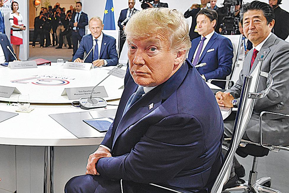 特朗普能否引用一項1977年的法律讓美企撤出中國引發關注。圖為25日特朗普在G7峰會上。(Getty Images)