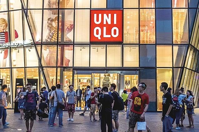 優衣庫(Uniqlo)營運商Fast Retailing大部份產品在中國生產,再向美國商店供貨。(Getty images)