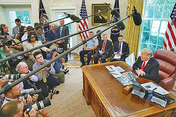 美國總統特朗普周三(9月4日)在橢圓辦公室表示,華為是一個國家安全問題,目前中美談判不希望討論華為議題。(AFP)