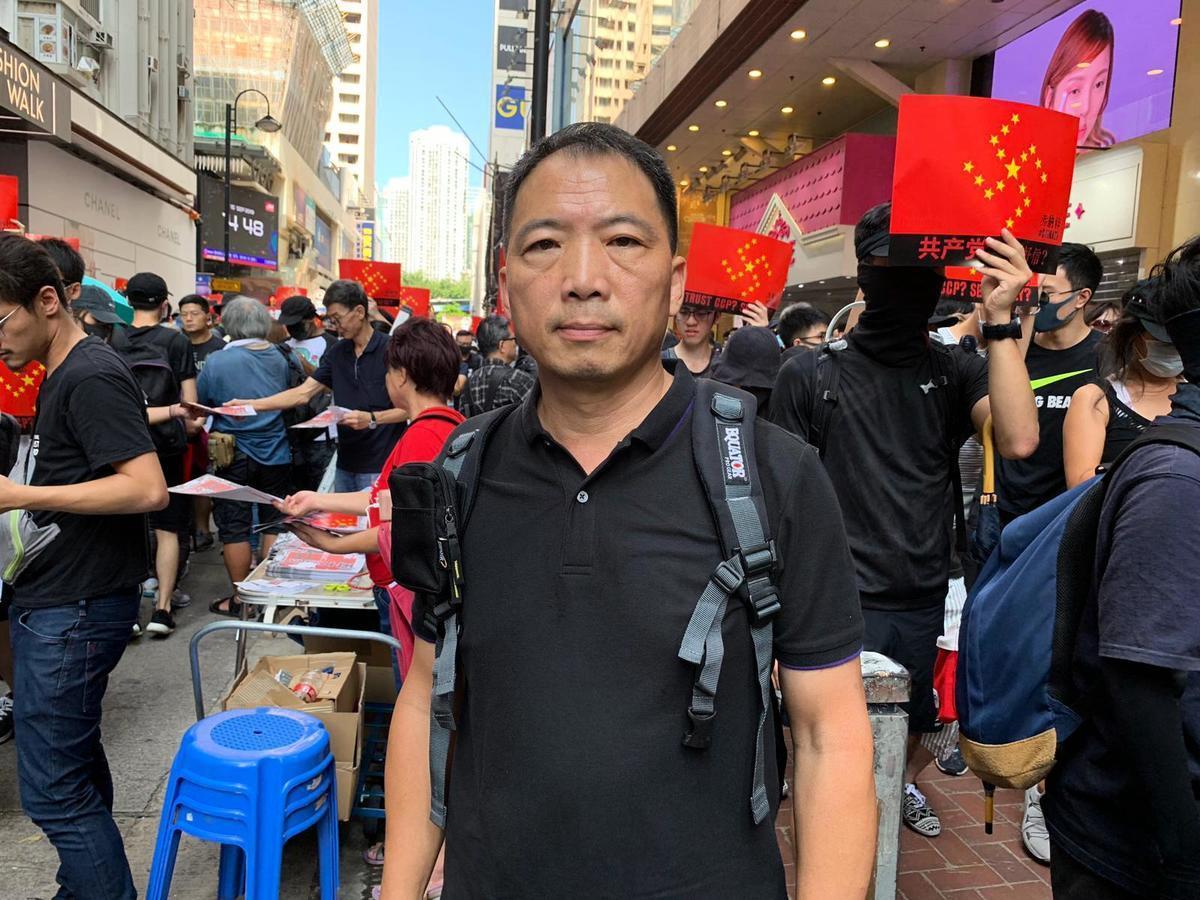 立法會議員,民主黨主席胡志偉表示,中共對示威者與對法輪功的手段如出一徹,香港其實需要止警暴,制黑亂。(王文君/大紀元)