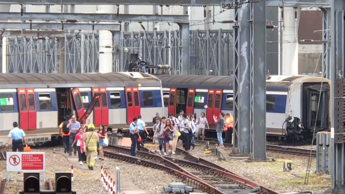 一列行駛於新界與市區之間的東鐵列車在紅磡總站斷裂成兩截,部份車門打開,旅客自行下車。(影片截圖)