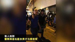 「福建男」襲擊記者 港警不抓反摟肩搭背