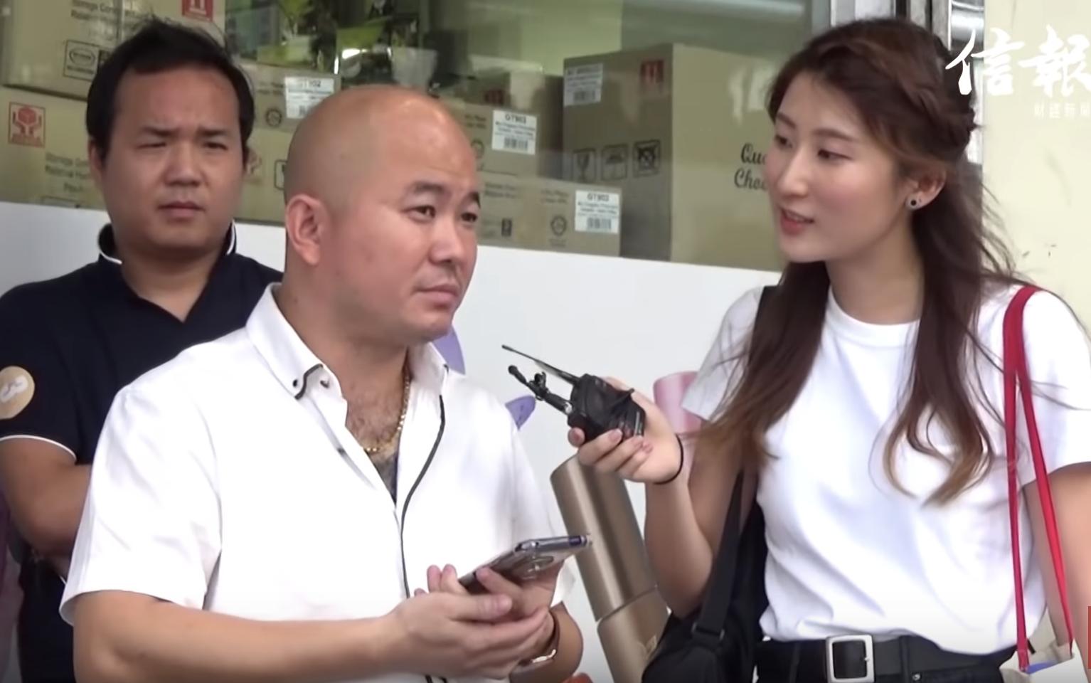《信報》就目前香港局勢採訪一名內地遊客,這名遊客稱,一些香港人是「沒腦子的暴徒」並聲稱如果碰上,要「以暴制暴」。(視頻截圖)