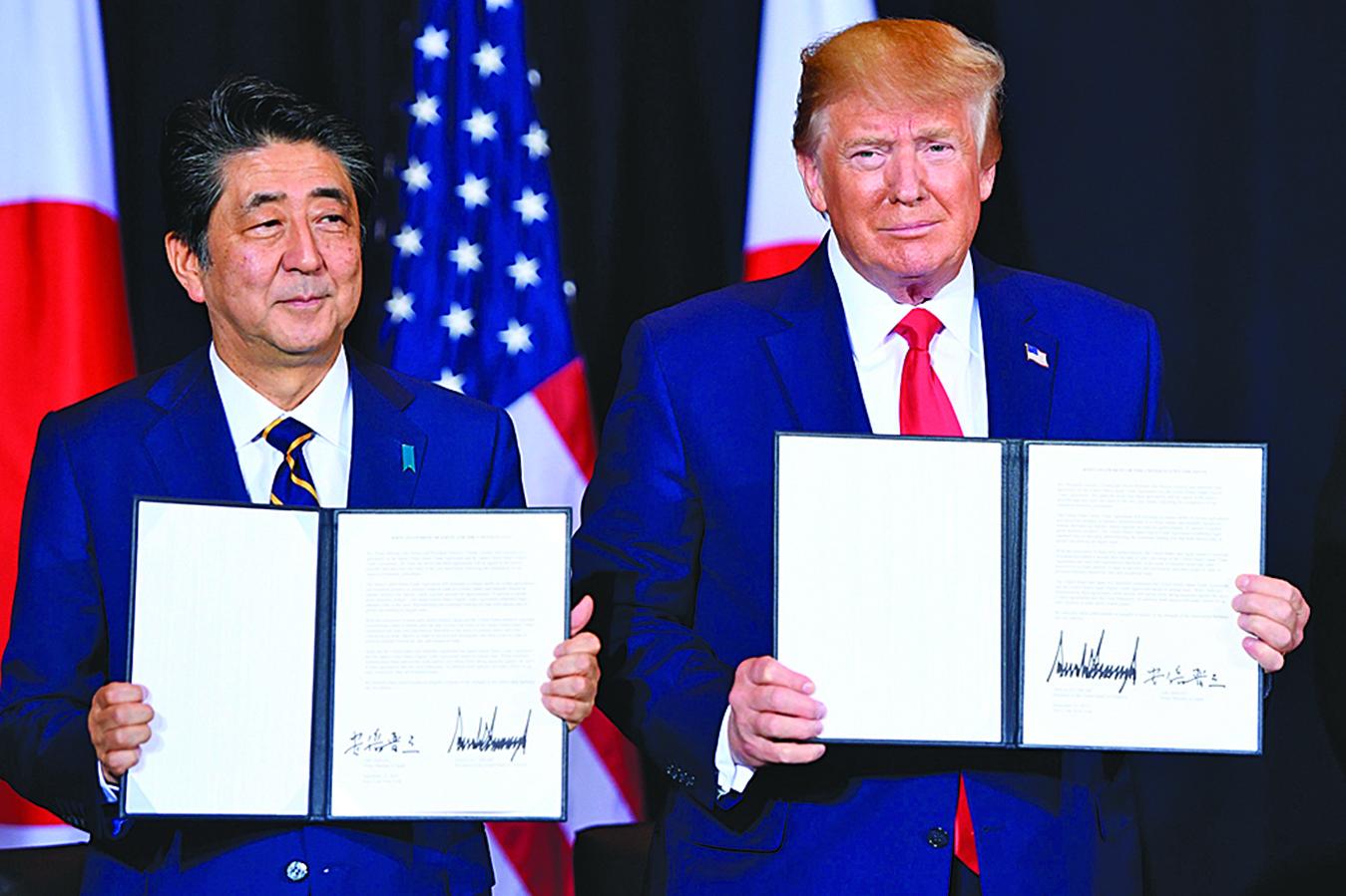 美國和日本於周三(9月25日)簽署初步貿易協議。美承諾在兩國談判期間不對日本汽車加徵關稅。(AFP)