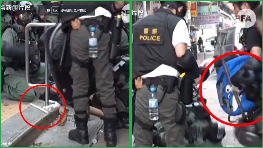 影片顯示,一名警察伸手欲取走曾志健身旁的白色膠管,而另一名警察將一支鐵通和曾志健的自製藍色盾牌等物品拿到一起。(影片截圖)