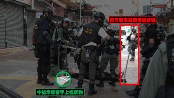 有警察從別處取來鐵通,遞給同僚。(影片截圖)