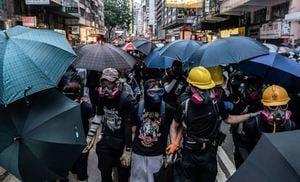 《衛報》:緊急法開啟極權時代 香港國際金融地位動搖